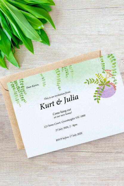 housewarming invitation of hanging plant illustration photographed with some natural plants and envelope