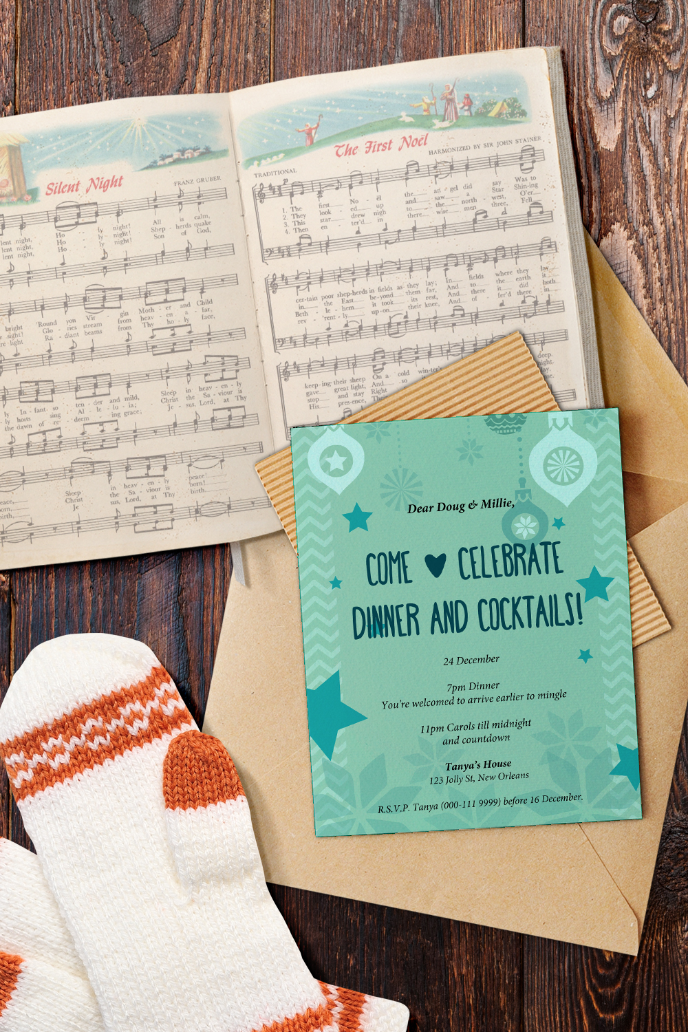christmas invitation splayed out of caroling book
