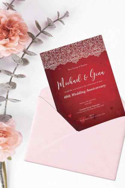 ruby wedding anniversary invitation pulled out of pink envelope